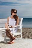 Young woman relaxing on the beach. Pretty young woman relaxing on the beach stock image