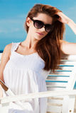 Young woman relaxing on the beach. Pretty young woman relaxing on the beach stock photography