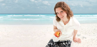 Young woman relaxing on a beach. Room for text. Royalty Free Stock Photos