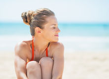 Young woman relaxing on beach Royalty Free Stock Image