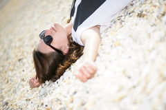 Young woman relaxing on a beach Royalty Free Stock Photo
