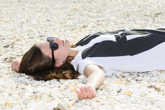 Young woman relaxing on a beach Royalty Free Stock Photography