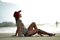 Young woman relaxing on the beach in summer Royalty Free Stock Photo
