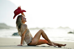 Young woman relaxing on the beach in summer Stock Photo
