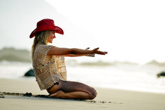 Young woman relaxing on the beach in summer Royalty Free Stock Image