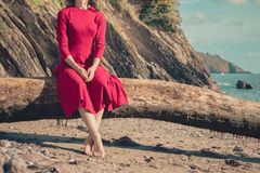 Young woman relaxing on the beach Stock Photography