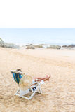 Young woman relaxing on a beautiful beach. Royalty Free Stock Photography