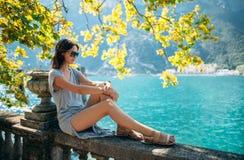 Young woman relaxing on beautiful Garda lake. Vacation concept Stock Photo