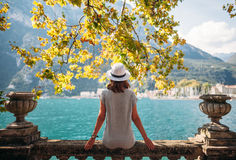 Young woman relaxing on beautiful Garda lake. Vacation concept Royalty Free Stock Photo