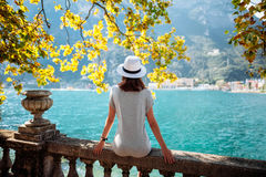 Young woman relaxing on beautiful Garda lake. Vacation concept Royalty Free Stock Images