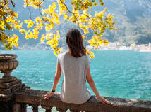 Young woman relaxing on beautiful Garda lake. Vacation concept Stock Images