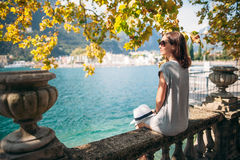 Young woman relaxing on beautiful Garda lake. Vacation concept Royalty Free Stock Photography