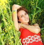 Young woman relaxing on a beautiful green meadow Stock Photography