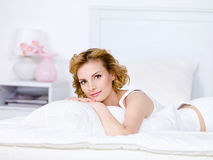 Young woman relaxing on a bed Royalty Free Stock Image