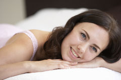 Young Woman Relaxing On Bed Stock Photos
