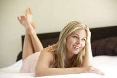 Young Woman Relaxing On Bed royalty free stock photo