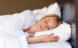Young woman relaxing in bed Royalty Free Stock Images