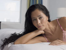 Young Woman Relaxing In Bed Stock Image