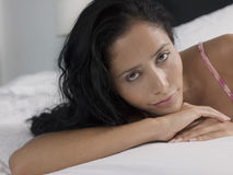 Young Woman Relaxing In Bed Stock Photography