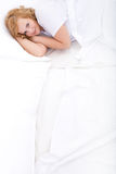 Young woman relaxing in Bed Stock Images