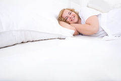 Young woman relaxing in Bed Stock Photos