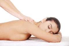 Young woman relaxing beeing massaged Stock Photos
