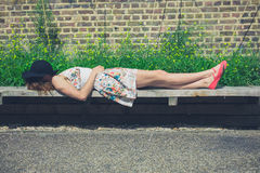 Young woman relaxing on bench outside Royalty Free Stock Photos