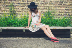 Young woman relaxing on bench outside Royalty Free Stock Images