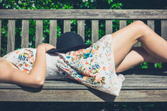 Young woman relaxing on bench in park Royalty Free Stock Images