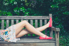 Young woman relaxing on bench in park Stock Photography