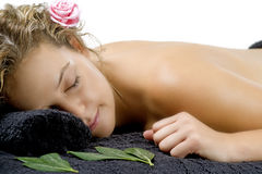 Young woman relaxing on black towel Royalty Free Stock Photography
