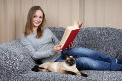 Woman with book and cat Royalty Free Stock Photo