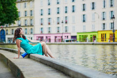 Young woman relaxing on Canal Saint Martin on a summer day in Paris, France Royalty Free Stock Images