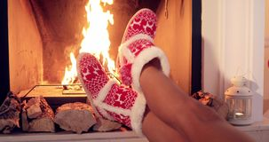 Young woman relaxing in Christmas booties stock video