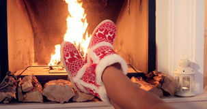 Young woman relaxing in Christmas booties Royalty Free Stock Photos