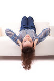 Young woman relaxing on couch Stock Photography