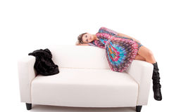 Young woman relaxing on couch Royalty Free Stock Photos