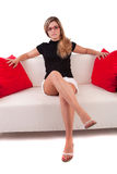 Young woman relaxing on couch Stock Images