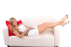Young woman relaxing on couch Royalty Free Stock Photo