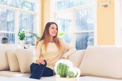 Young woman relaxing on a couch Stock Photo