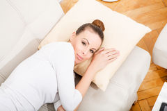 Young woman relaxing on the couch Royalty Free Stock Photography