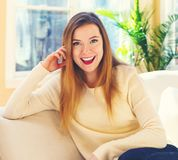 Young woman relaxing on a couch Stock Images