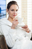 Young woman relaxing with cup of tea Royalty Free Stock Images