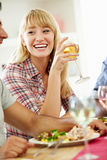 Young Woman Relaxing At Dinner Party Royalty Free Stock Photography