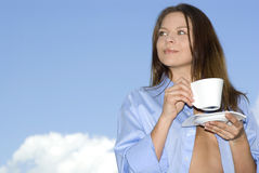 Young woman relaxing, drinking coffee.  royalty free stock images