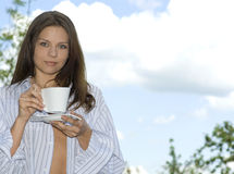 Young woman relaxing, drinking coffee.  royalty free stock photos