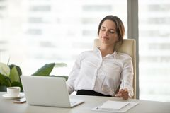 Young woman relaxing enjoying break on comfortable ergonomic off. Young happy woman relaxing enjoying break feeling no stress free relief after computer work stock photography