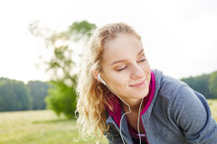 Young woman relaxing and enjoying royalty free stock images