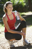 Young Woman Relaxing After Exercise And Drinking Water Stock Image