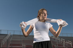 Young woman relaxing after exercising outdoors Stock Photography